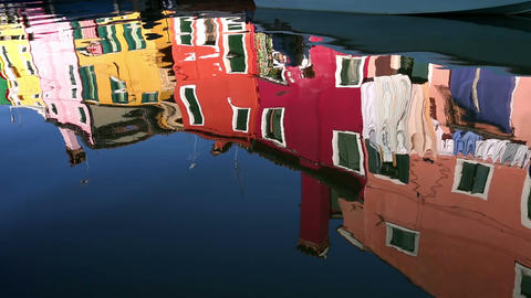 Reflection of a colorful houses in water canal, Burano island, Venice, Italy Footage