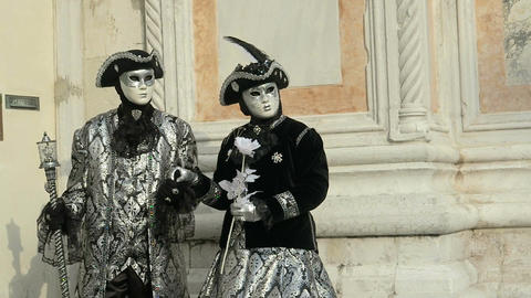 Venice, Italy - February 2017: Carnival mask and costume couple poses Footage