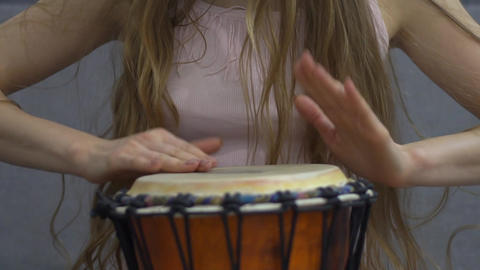 Girl Playing Bongo Drum Close Up Footage