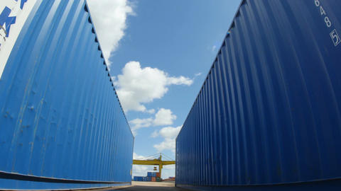 Motion between Blue Big Containers in Blue Sky Background Footage