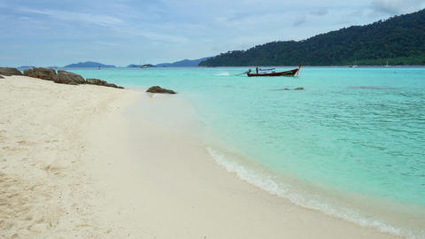 White sandy beach and boat in sea on Koh Lipe Footage