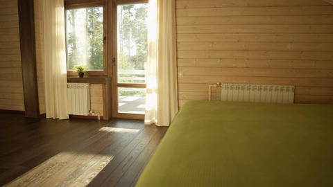 Illuminated by Sunset Light Bedroom in Wooden House Live Action