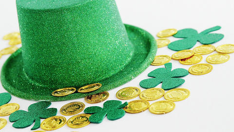 Leprechauns gold and hat with shamrocks on white background for st patricks Live Action