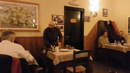 Waiter is serving guests in small italian restaurant Footage