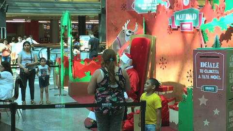 Kid anxious to see Santa Claus has to wait Footage