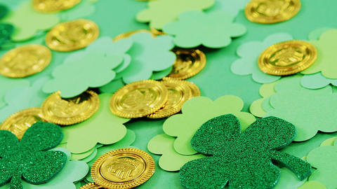 Green shamrocks and leprechauns gold on green background for st patricks Live Action