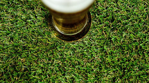 Pint of beer on grass for st patricks Live Action