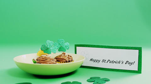 Happy St Patricks day message with a plate of chocolate muffin for st patricks Footage