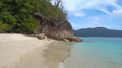 Deserted sandy beach and rock on island Footage