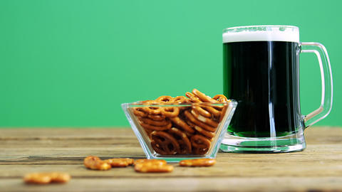 Guinness pint with bretzels ontable for st patricks Live Action