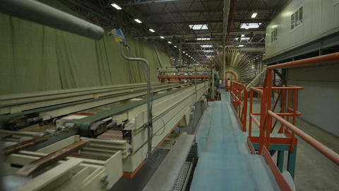 Camera Moves along Conveyor for Chipboard Production Footage
