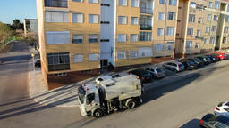 street sweeper truck road cleaner sweeping vehicle machine clean cleaning curb Footage