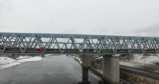 Movement of freight train through the railway bridge Footage