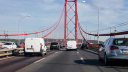 suspension bridge driving through crossing 25 de Abril Lisbon cars automobiles Footage