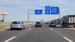cars automobiles highway driving through Lisbon Porto Oporto speed fast motorway Footage