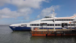catamaran ferry boat moored pontoon terminal pier ferry boat waiting passengers Footage