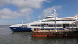 catamaran ferry boat moored pontoon terminal pier ferry boat waiting passengers Footage
