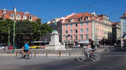 Cais do Sodre Lisbon Duque da Terceira square district carris bus buses yellow Footage