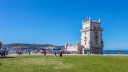 Lisbon Belem Tower gothic castle tourists visit visiting tagus river lawn green Footage