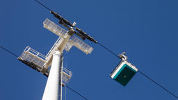 Aerial tramway cable car gondola lift tower wheels passing over passing by close Footage