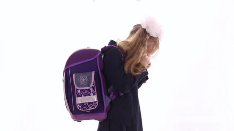 Schoolgirl with a huge backpack is crying Live Action