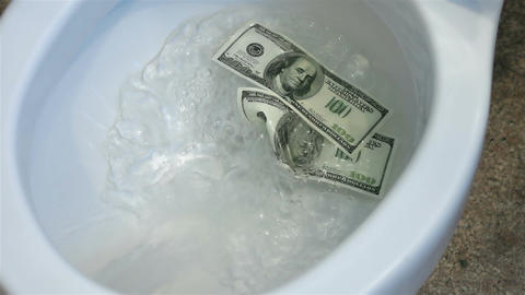 Video of flushing dollars in toilet bowl in real slow motion Filmmaterial
