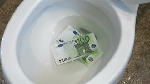 Video of flushing euro banknotes in toilet bowl in real slow motion Live Action
