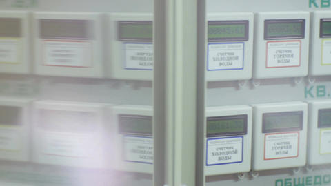 Automatic Meters in Apartment House Through Glass Footage