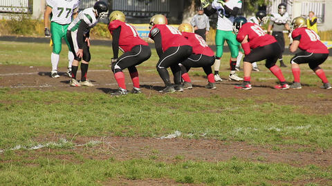 Offense players attacking defense team during match, American football game Live Action