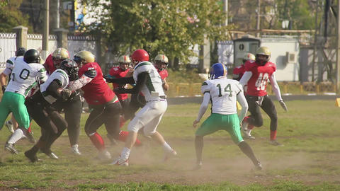 Violent attack in American football, offense team tackling rival defense players Footage