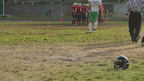 Football players standing in circle on pitch and discussing game strategy Footage