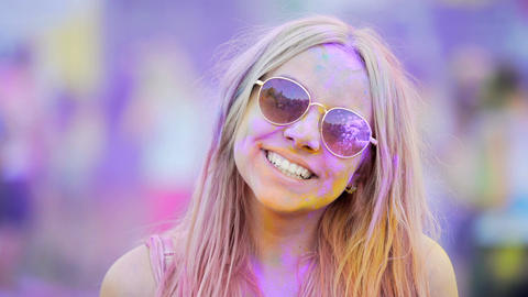 Girl in sunglasses making thumbs-up, looking through rose-colored spectacles Footage