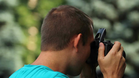 Inspired male photographer taking picture of nature, enjoying hobby at leisure Footage
