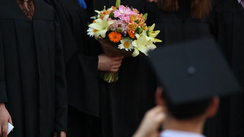 Excellent university graduates proudly posing for picture, successful future Live Action