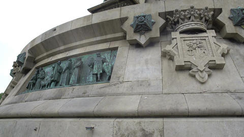 Columbus Monument in Barcelona, bronze bas-relief panels on pedestal plinth Footage