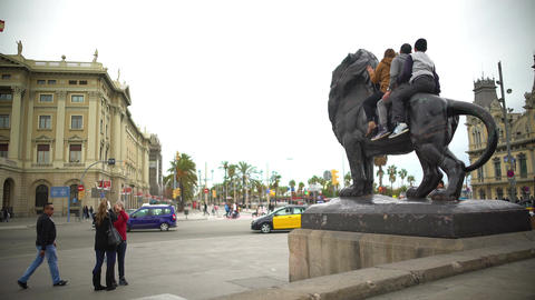 Happy travellers sitting on bronze lion sculpture, posing for funny selfie Footage
