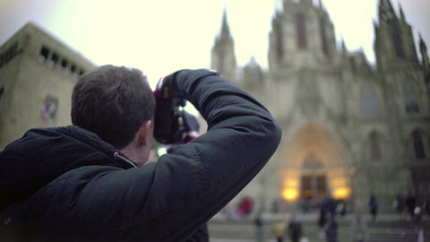 Excited male tourist taking picture of Gothic cathedral, travel impressions Live Action