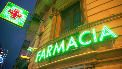Farmacia LED sign on drugstore, retail store selling medication, pharmaceuticals Footage