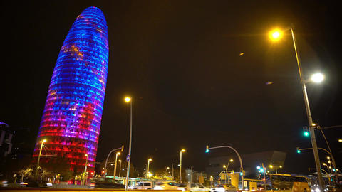 Torre Agbar tower shining with colorful lights, night Barcelona, architecture Footage