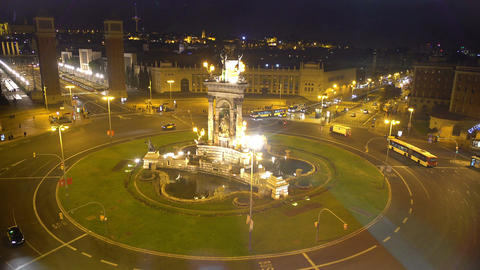 Traffic on amazing central square in Barcelona, Spain, night view from elevator Footage
