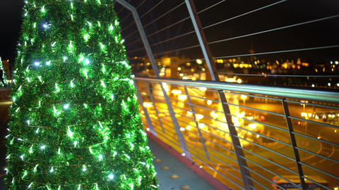 Nice illuminated Christmas tree on top of skyscraper, festive night city lights Footage