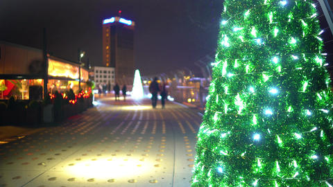 Christmas atmosphere in night city, happy couples enjoying dates, time lapse Footage