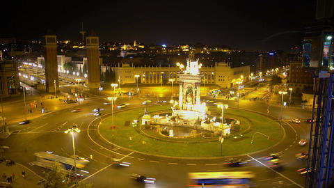 Active traffic on circle road around fountain on Plaza de Espana in Barcelona Footage