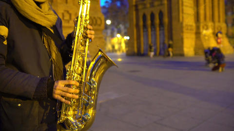 Musician playing saxophone music, nice romantic atmosphere, date in night city Footage