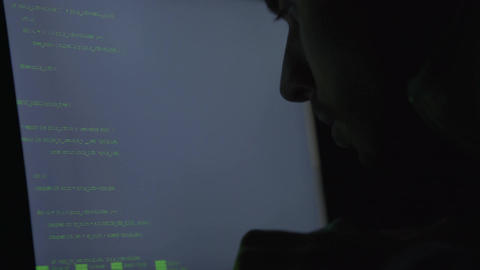 Man hacking website at night, typing code to breach the system, cybercrime Footage