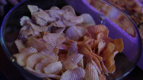 Potato chips on a plate Archivo