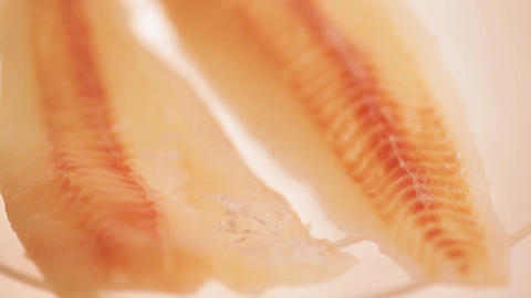 Raw fish fillet on a transparent plate Live Action