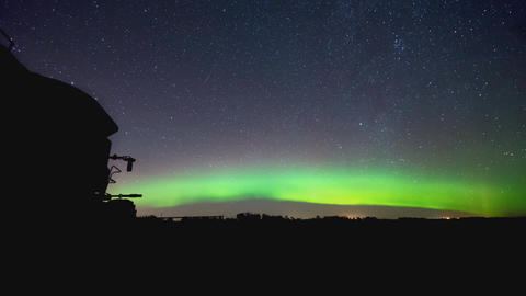 Northern lights over farm field Footage