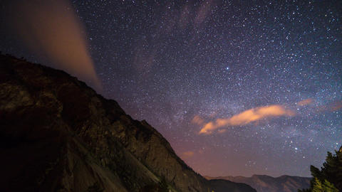 time lapse of stars moving above a mountain Footage