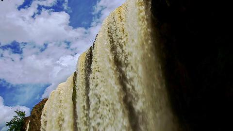 Closeup Powerful Waterfall Flow by Rocks with Mist under Sky Footage
